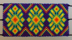 """This is a Huichol tribe hand-made beaded bracelet featuring 3 primary cactus symbols.<br />  <br />  Cactus (hikuri): For the Huichol people (Wixarika), the cactus (el hikuri) is a very important religious symbol and is one of the means by which shamans (mara'kames) have to make contact with their Gods. Cactus also represents nourishment, and in some way the corn of the Huicholes.  According to Huichol (Wixarika) cosmology, the God """"Our big brother blue deer"""",  in his effort to lift his…"""