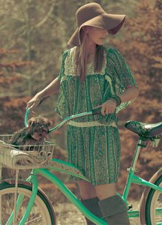 Love the hat, bike, dress, and boots!