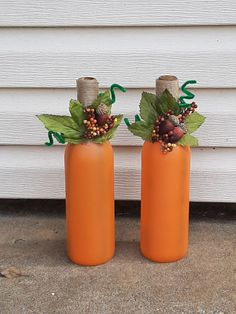Fall pumpkin decorative wine bottles Wine bottles that have been painted and decorated to resemble pumpkins with fall decor. Hand made. Fall Wine Bottles, Halloween Wine Bottles, Wine Bottle Crafts, Autumn Crafts, Thanksgiving Crafts, Holiday Crafts, Adornos Halloween, Halloween Crafts, Fall Diy