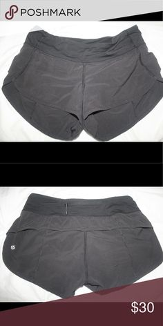 Lululemon Speed Short Black Lululemon Speed Short size 4. Zipper in the back and built in black underwear. The photo looks like they are charcoal but they are black, the flash altered the color in the picture. lululemon athletica Shorts