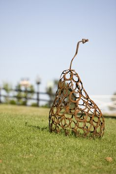 Pear sculpture made of horseshoes at a rural retreat - photo from peterfudgegardens   ...artist not listed...