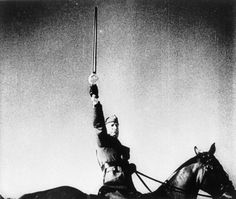 "Italy's dictator Benito Mussolini is deposed. 25 July 1943. Mussolini in Tripoli during a visit to Libya. He is pictured on horseback brandishing the ""Sword of Islam"" which was presented to him by an Arab delegation. His plans to grab Egypt from the British had been a humiliating failure – now Italy faced even worse war on home soil."