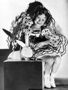 Shirley Temple with a bunny given her as an Easter present by Joel McCrea. March, 1936