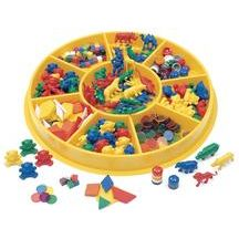 "Sorting Center - 341 Pieces - Set includes:  *Dishwasher safe bright yellow sorting tray  *48 counter bears  *40 wild animal counters  *40 stacking counters   *80 cube counters  *84 transparent overhead counters  *48 pattern blocks and activity guides  *Tray measures 15 3/4""Dia. with 9 wells that measure 1 1/2""D    $39.99"