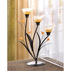 AMBER LILIES TEALIGHT HOLDER Store wide sale 20% off all orders use code cybersale!