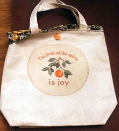 Tote Bag with an Embroidered Quilt Block, Like the idea of making a circle applique rather than square !  found on Emblibrary