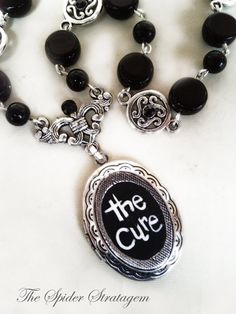 Gothic necklace 'The Cure'. - One of a kind. Hand-carved logo on locket pendant,black glass beads,jet black rhinestones,silver components. - For any question feel free to contact me and thank you for visiting! Victorian Jewelry, Victorian Gothic, Gothic Jewelry, Boho Jewelry, Jewelery, Jewelry Accessories, Handmade Jewelry, Jewelry Design, Gothic Clothing