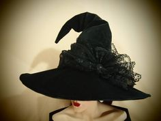 Weve made the base of this hat out of black velveteen and simply adorned with a…