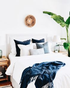 traditional meets modern bedroom design with modern neutral bedding, modern neutral bedroom design and chandelier, coastal bedroom decor with blue and white bedroom decor Blue Bedroom Decor, Bedroom Inspo, Bedroom Ideas, Navy Home Decor, Bedroom Designs, Bedroom Images, Bedroom Chair, Bedroom Inspiration, Indigo Bedroom