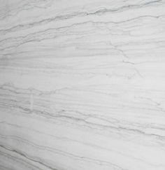 Quartzite Bianco Macabus quartzite which performs like a granite in terms of durability but has a look more like marble than granite.  It seems to be called many things but in the yards we went to it is going by the name Bianco Macabus.