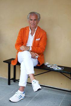 Summer Inspiration shot by The Sartorialist The Sartorialist, Best Mens Fashion, Look Fashion, Estilo Street, Orange Blazer, Orange Jacket, Bright Jacket, White Chinos, White Jeans