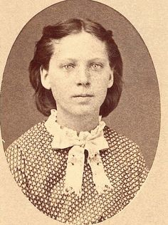 A portrait of Sophia German, who was taken captive, with her younger sisters, Catherine, Julia, and Adelaide, by Cheyenne Indians after their family were killed. On September 11, 1874, the John German family, consisting of his wife and seven children, were attacked by a band of Cheyenne one day's journey east of Ft. Wallace, Kansas. Only the four youngest, Sophia, Catherine, Julia, and Adelaide, were spared and taken captive.