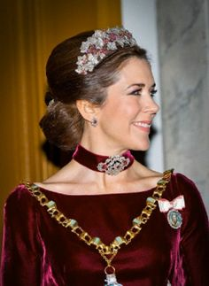 Crown Princess Mary of Denmark wears a Ruby Parure Tiara as she attends the 2014 annual New Years reception at Amalienborg Palace in Copenhagen, Denmark