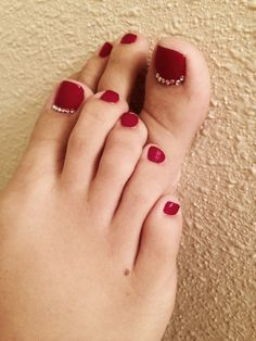 Deep red toes with little rhinestones on the big toes!