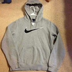 Nike pullover hoodie Size medium.  Very comfy and cute. One small stain on third picture.  And also the top was cut as shown in second picture.  I do trade!  Bundle to save:) Nike Sweaters