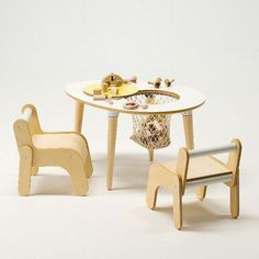 Egg table and children's chairs by Cosine