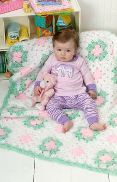 Flowers In The Dell Crochet Pattern - Worked in lofty yarn and pretty colors, this basic crocheted granny square blanket is the perfect baby gift. Since yarn is super bulky it won't take long to crochet.
