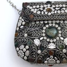 """HP Amazing Vintage Metal Embroidery clutch Vintage, Amazing Statement piece. Beautiful!!! Pictures dont do justice. It has all stones in place and metal work is in perfect condition. Inside it has a black velvet cover. No pockets. It closes with a metal hook that it has inside. While it looks heavy, it is not. Shoulder drop is about 18"""" inches. Chain shoulder string. This is in amazing condition. No signature or visible signs of any brand. Vintage Bags"""