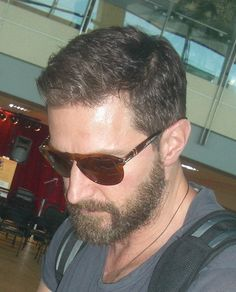 The shades. The beard. The touchable hair asking to be ruffled. The casual attire. Just a fine specimen of masculintiy.