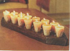 Candles resting on wooden panel Pillar Candles, Candle Jars, Accent Pieces, Tea Lights, Decor, Decoration, Tea Light Candles, Decorating, Candles