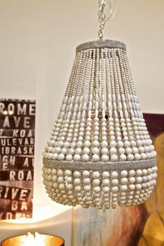 Malibu Beaded Pendant Light - White Beads and Silver Hemp. With a striking design that mixes artistic elements and modern style, this pendant is a showstopper. Its creative bead design and hemp-wrapped frame make this a truly unique fixture.