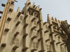 Africa | Detail from the Mud Mosque in Mopti, Mali | ©JessiRCohen