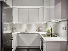 cocina blanca - Un piso de 44 m2 en el que se aprovecha cada rincón
