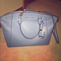 Michael Kors purse 100% authentic!! Beautiful soft leather. Light blue color. Can be worn as a cross body or with handles. New with tags!!! I got this for Christmas but have a similar color so I decided I would like to sell. MICHAEL Michael Kors Bags