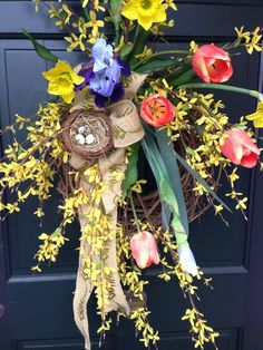 The burplap bow and egg nest are the perfect finishing touch for this easy Spring wreath.