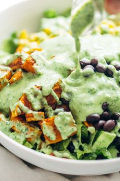 Cilantro Avocado Dressing - so easy and it goes on anything! made with simple ingredients like cilantro, avocado, Greek yogurt, garlic, and lime juice. LOVE! | pinchofyum.com