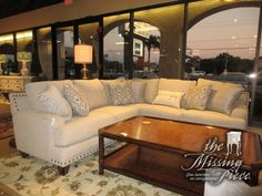 """The Anna three piece sectional in a beige upholstery with a mix of patterned accent pillows and dark nailhead trim. Beautiful lines! Ideal for a contemporary style space! 100""""long x 100""""wide x 36""""high. Arrived: Monday December 5th, 2016"""