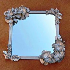 "Clever Dollar Store Ideas That Will Have You Saying, ""How'd They Think Of That?"" Make this Anthropologie-inspired mirror with a dollar-store mirror and silk flowers.Make this Anthropologie-inspired mirror with a dollar-store mirror and silk flowers. Diy Projects To Try, Crafts To Make, Fun Crafts, Craft Projects, Craft Tutorials, Spray Paint Projects, Decor Crafts, Home Projects, Dollar Store Mirror"