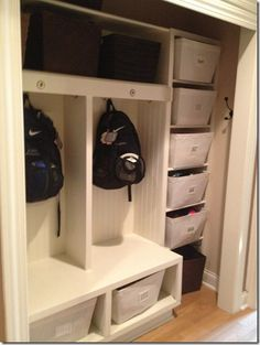 Off our mud room you will find a closet converted to lockers. I like the column of bins on the side for sports gear!                                                                                                                                                     More