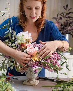 Pick Your HeroesNestle your most visually dominant flowers (often peonies or larger roses) among your strong stems. Avoid placing these floral stars dead center -- position slightly to one side or another. Fill in gaps with a dainty branch, berry, or flower.