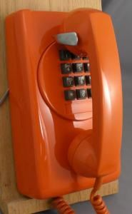 """Northern Electric"" *orange* 3554 touch tone wall phone with round dial mount."