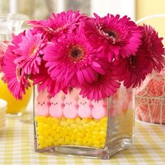 Easter Peeps Centerpiece | Taste of Home Recipes. Use two different size glass vases & fill the space between the two with the jelly beans and rabbits.  The inner vase holds the flowers. Ease, cheap and super cute!