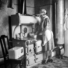 Vintage Kitchen Photographic Print: Woman Cooking on Old Fashioned Stove Poster by Walter Sanders : - size: Photographic Print: Woman Cooking on Old Fashioned Stove Poster by Walter Sanders : Artists