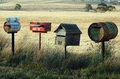 Being creative with country mailboxes how about using a tool box, tin can, wooden barrel, and barn wood