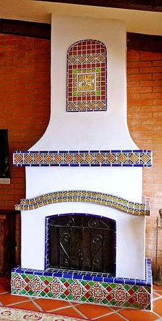This kitchen fireplace is so dreamy with Mexican tile designs from bottom to top. Stucco Fireplace, Backyard Fireplace, Home Fireplace, Fireplace Design, Outdoor Fireplaces, Mexican Style Homes, Spanish Style Homes, Spanish House, Spanish Home Decor