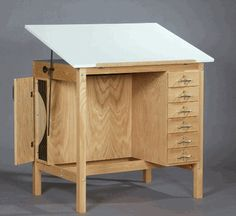 Drawers, place for paintings, adjustable board... I like.