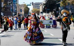 (left-right) Members of You Art San Jose Brenda Galvan, Rafael Sanchez participate in the traditional Day of the Dead procession from City View Plaza to San Jose State in downtown San Jose, Calif. on Sunday, Oct. 15, 2015. (Josie Lepe/ Bay Area News Group)