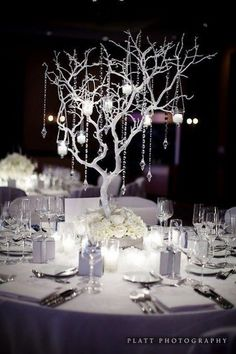 Best Winter Wedding Decorations Ever - Crystal Tree and Candle Centerpiece! Check out the blog for other winter wedding decoration ideas, including: snowflakes | blanket chair covers | berries | pine cones | candles | feathers | baby's breath flowers | Christmas lights | fairy lights | sleds | stocking silverware pockets | sweater vases | crystals | wedding planning | wedding ideas | winter decor | www.templesquare.com/weddings/blog