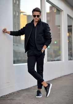 Adam Gallagher Wearing: Express black joggers, wool blend bomber jacket, cotton Henley & creative recreation Sneakers.