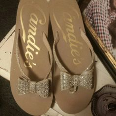 Candies flip flops with shimmery BOWS!! Candies flip flops with shimmery BOWS!! Size M (7-8). Worn once. Look new! Candie's Shoes