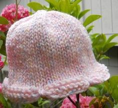 Scallop Edge Baby Hat - Keep your baby's head warm with this Scallop Edge Baby Hat. This adorable free knitting pattern is one you'll want to keep on hand for all of the precious little ones in your life. The decorative scallop edge creates just the right amount of intricacy and is perfect for beginners learning how to knit a hat. The pattern is flexible and you can make it on either a circular needle or with double point needles, making it excellent when you want a quick knitting project.