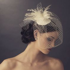 Modern meets vintage, with this elegant ivory or white Russian Tulle Face Cage Bridal Hat. This accessory is the perfect touch for an old fashion 20's wedding style ceremony. This piece has a gorgeous
