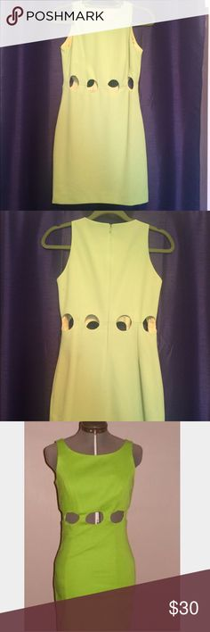 """💚RARE Vintage 90's Cut-Out Dress💚 90's Mod Style Mini Dress.  Circle cut-outs at  high waist.  Crepe material. Fully lined.  Hidden zipper at back.  Size 6 but seems it would fit 4/6.  Approximate measurements laying flat : Length 33""""  Waist 14""""  Bust 17"""" some  discoloration/spots at lower back near hem and back near arm hole as shown in last photo.  Not very noticeable when wearing but they may come out with dry cleaning. Actual Color not as bright as it appears in photo 3. Laundry by…"""