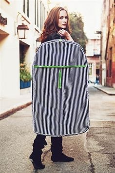 Cute garment bag! black + details = chic travel style.