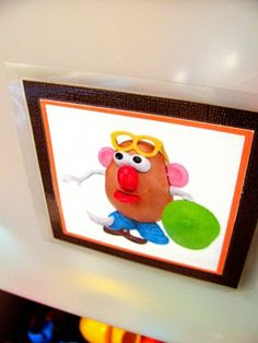 googled images laminated on front of toy bins