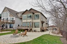 Prime location on Fox Lake! 2 story home w/ panoramic lakeviews, HW floors & 9ft ceilings thru out the first floors. The nicely appointed kitchen features, 42' maple cabinets, quartz countertops, breakfast bar, built in cooktop, tile backsplash, wine cooler & 2 pantries. Architectural beams run through the great room & dining room. Great room offers a direct vent FP w/quartz hearth and stunning views of the lake. Beautiful maple built in china hutch in the DR. Glass french doors lead into…